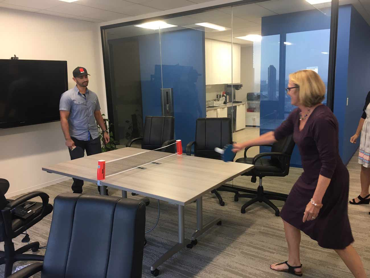 Our CEO Lisa takes on a challenger in an impromptu table tennis game.