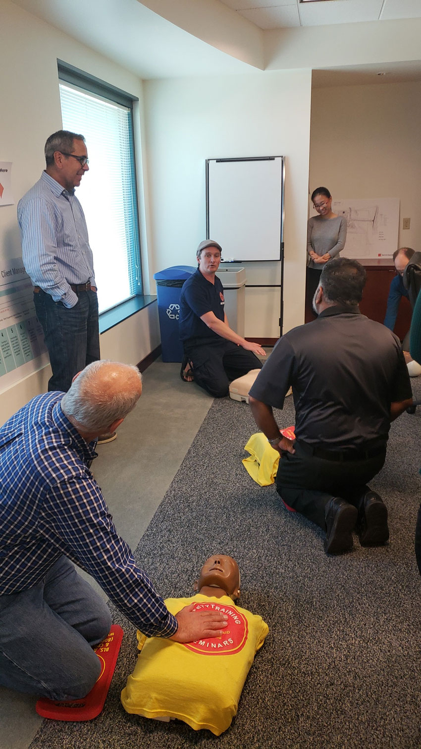 Harris employees learning CPR and other life-saving techniques.